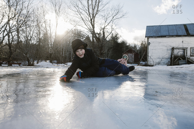 Kids playing on ice in country yard