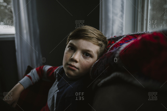 Boy on couch in wintertime