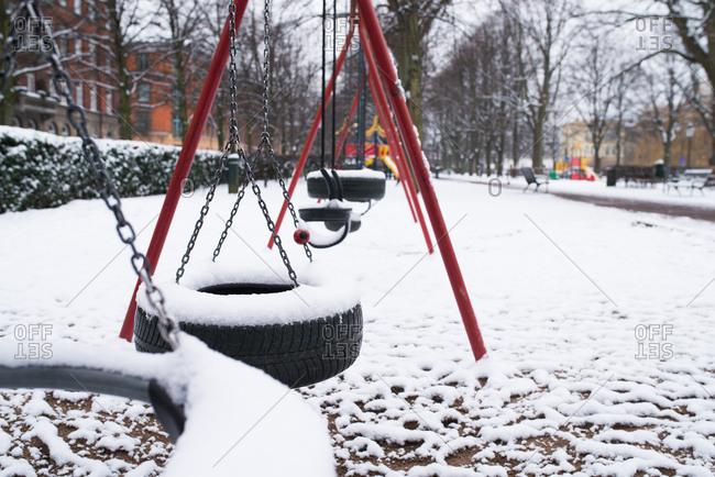 Snow on tire swings in city park