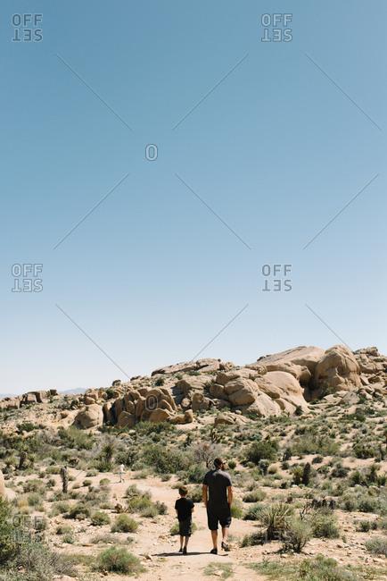 Dad and boy exploring desert park