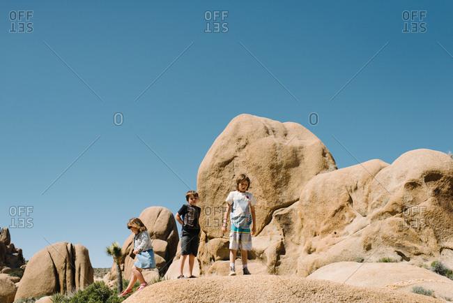 Kids on rocks in a desert setting