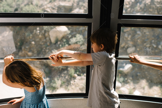 Kids at window with view of nature