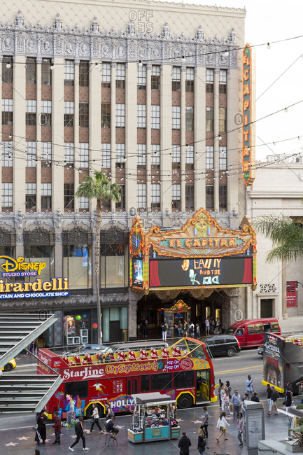 Los Angeles, California, USA - April 26, 2017:Tour bus in front of theater in the Hollywood district in Los Angeles