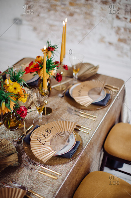 Gold Theme Dining Table Decor With Paper Fan Place Markers Stock Photo