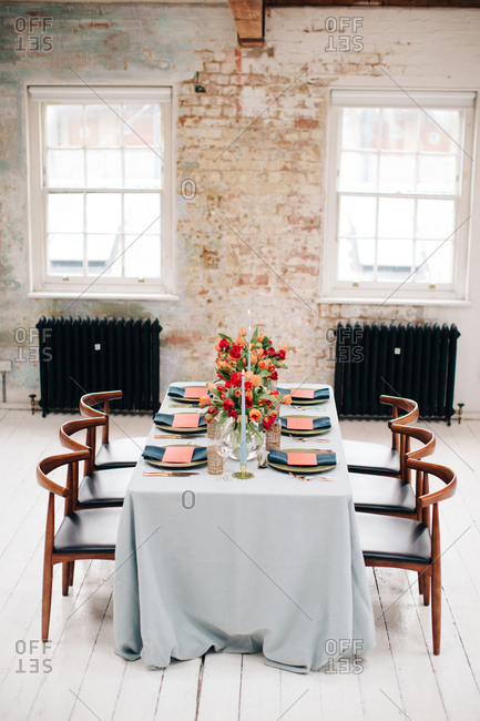 Modern dining table with pink and red tulips
