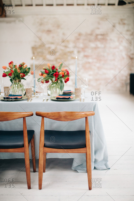 Danish modern dining table set with red tulips
