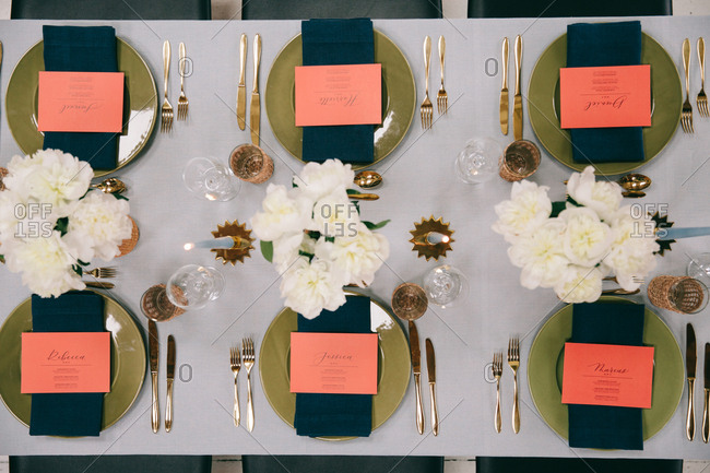 Overhead view of table with vases of white peonies