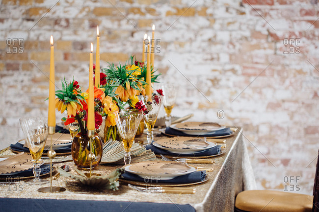 Table with elegant golden candles and floral arrangements