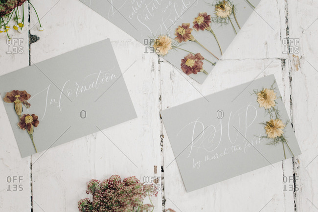 Wedding invitations with pressed flowers