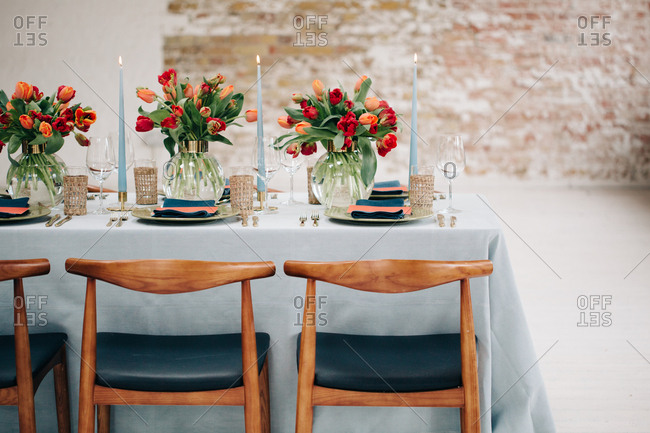 Blue dining table with coral flowers and accessories