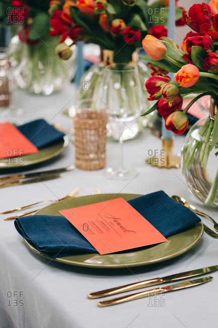 Coral menu cards at each place setting on dining table