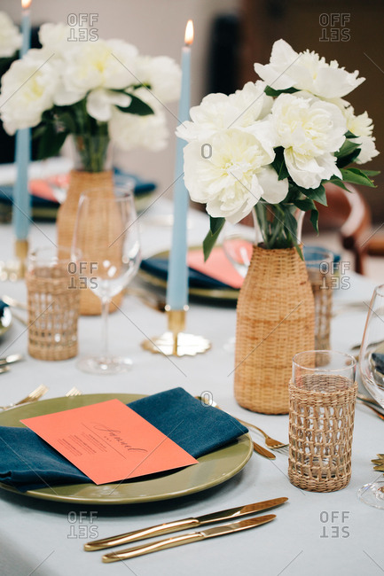 Dining table set white peonies and coral menu cards