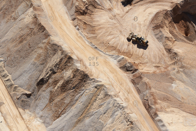 USA- Texas- aerial view of sand mine near San Antonio with a grader moving sand