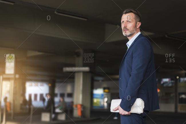 Businessman waiting at bus terminal