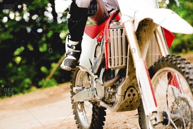 Italy- Motocross biker ridding in Tuscan forest