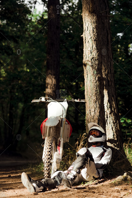 Italy- Motocross biker taking a break in Tuscan forest