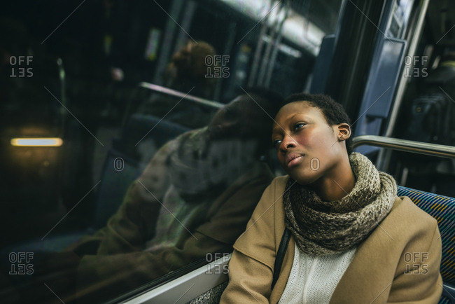 Portrait of young woman in underground train