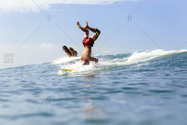 Surfers doing tricks on the sea