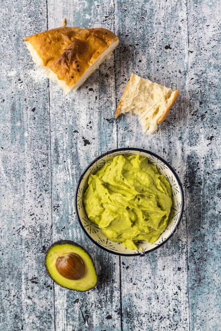Bowl of avocado hummus- half of avocado and flat bread