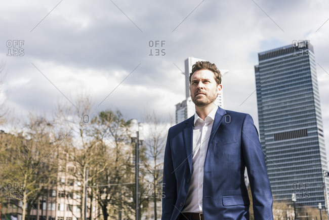 Successful businessman walking in the city