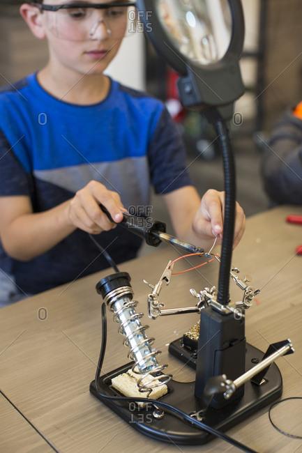 Child at soldering station