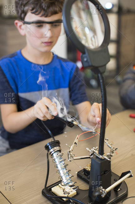Child at soldering station