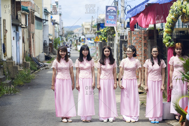 Da Lat, Vietnam - May 27, 2016: Young girls line up in anticipation for a wedding Vietnamese wedding ceremony.