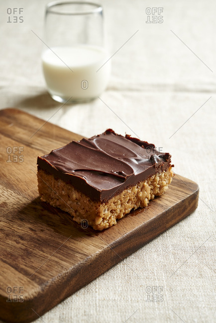 Peanut butter chocolate bars on plate and milk