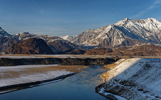 River at sunset with mountains in background