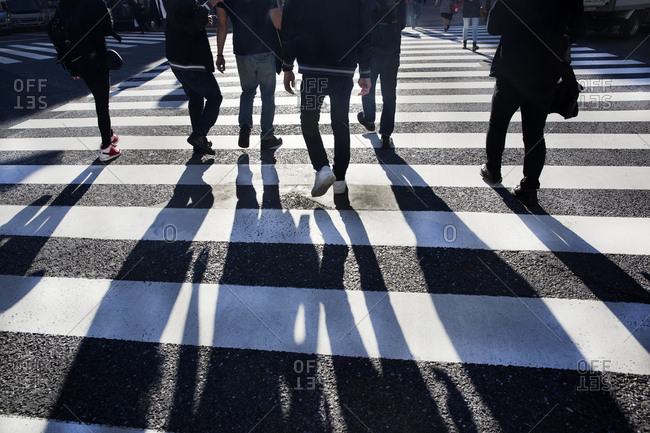Many people in the crosswalk at the Shibuya crossing in Tokyo, Japan