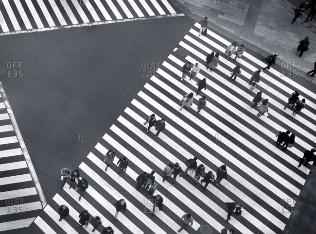 Tokyo, Japan - November 22, 2015: Many people crossing the street at a busy intersection in the Ginza district