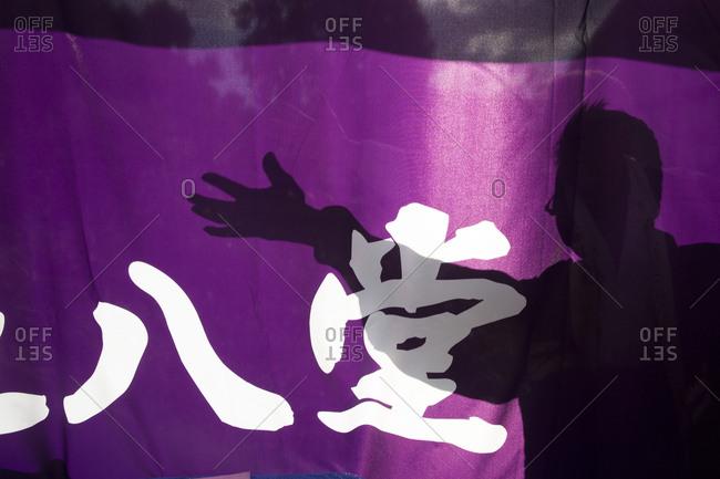 Kyoto, Japan - November 27, 2015: Shadow of a cook at a snack food shop at a temple