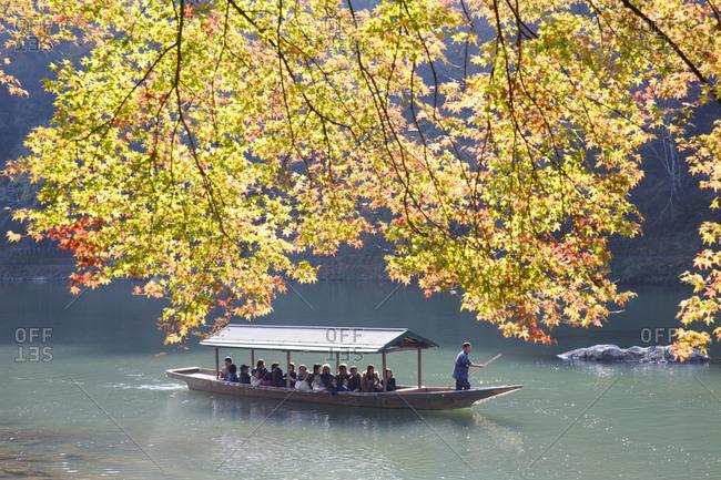 Kyoto, Japan - November 28, 2015: Tourists on boat at Arashiyama Park