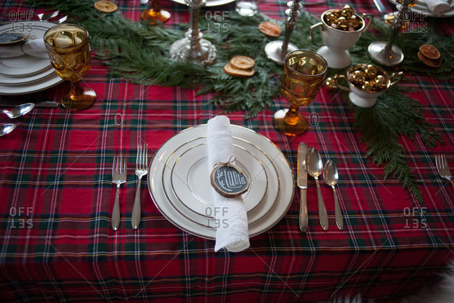 Place setting at a table decorated for Christmas