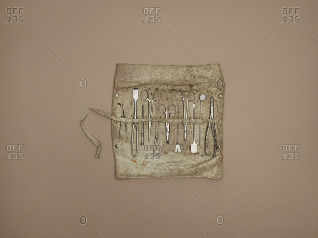 Directly above shot of various medical tools on beige background