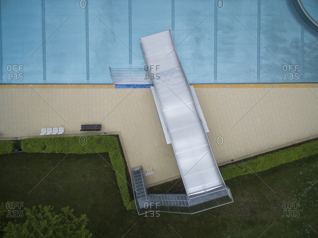 Directly above view of metal slide by pool, Sindelfingen, Baden-Wuerttemberg, Germany