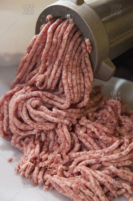 High angle view of meat being minced in factory