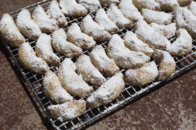 Close-up of powdered sugar covered cookies on tray