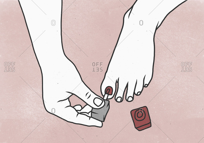 Cropped image of woman applying nail polish on toe nail