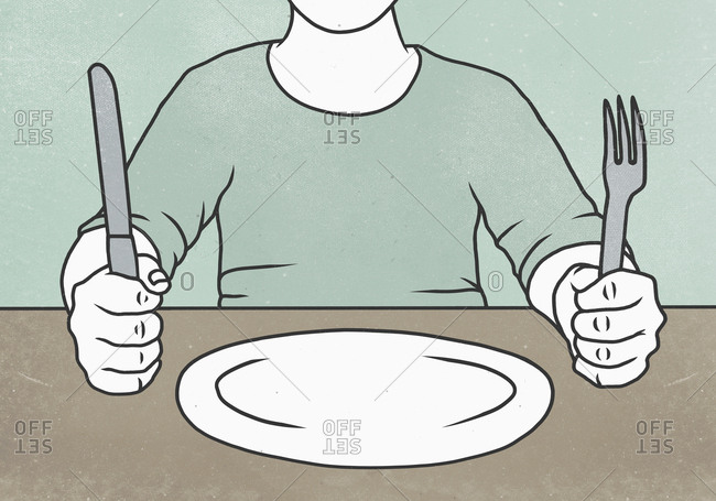 Midsection of man holding fork and knife at table