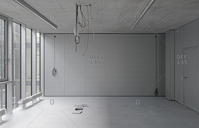 Interior of empty office with cables hanging from ceiling