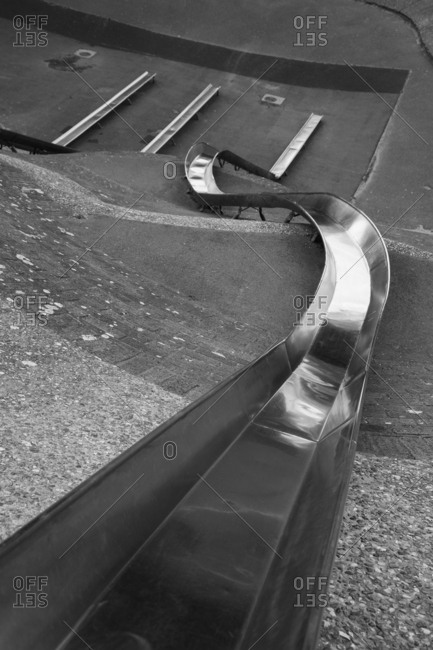 High angle view of long metal slide in park