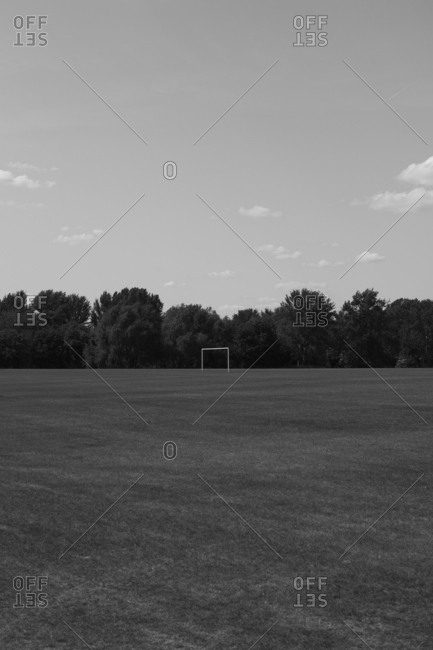 Distant view of goal post on soccer field against sky