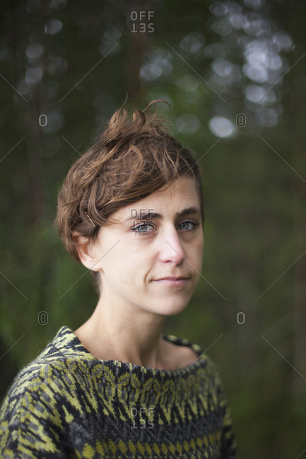 Close-up portrait of woman in forest