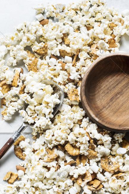 Popcorn kernels with crushed pretzel crackers