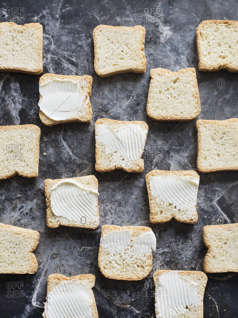 Mini toasts served with cream cheese