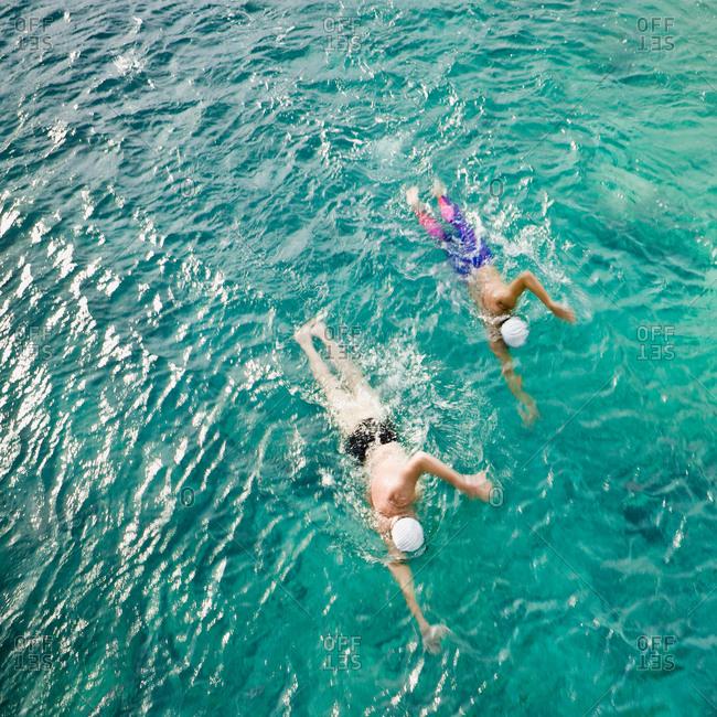 Men swimming in sea