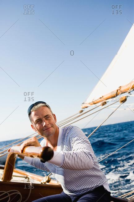 man steering a sailing boat