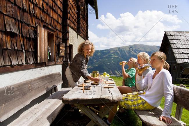 family having picnic at mountain hut