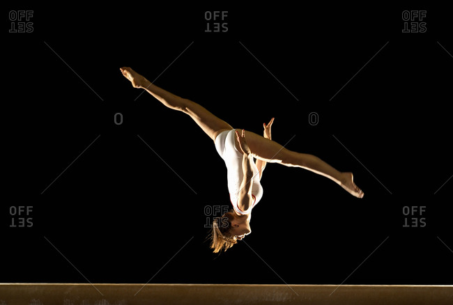 Gymnast jumping on beam - Offset